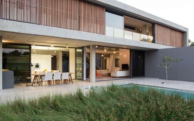 Дом в стиле минимализм с бассейном от Thomas Gouws Architects
