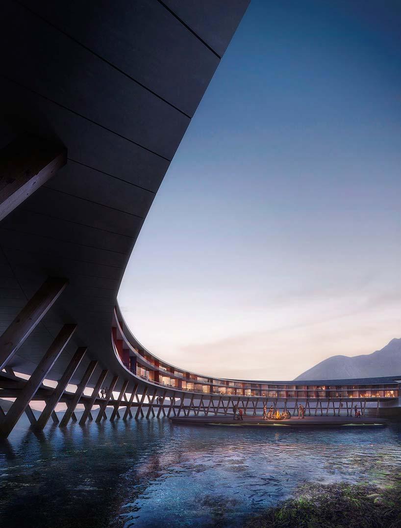 Отель кольцо у подножия горы в Норвегии на берегу фьорда