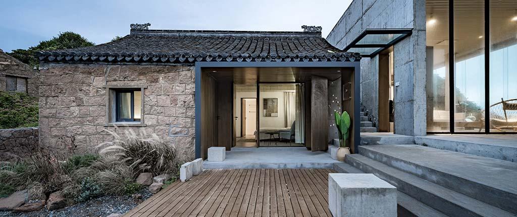 Старая каменная кладка и новый бетон в доме от Evolution Design