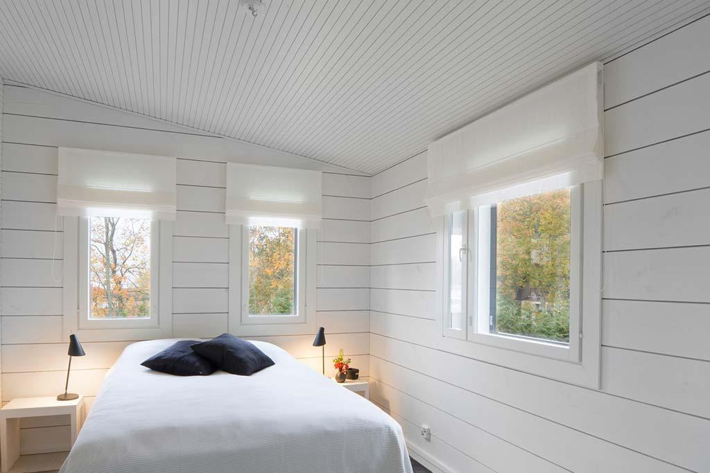 Спальня в доме из клееного бруса от Pluspuu Oy