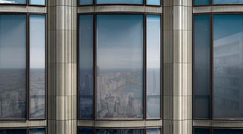 Стеклянно-металлический фасад башен