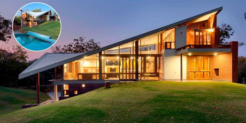 Загородный дом с параболической крышей от Studio 4000